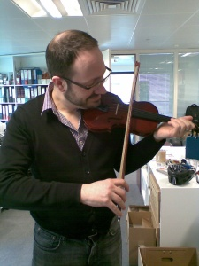 Tiny violin. Not a giant person.